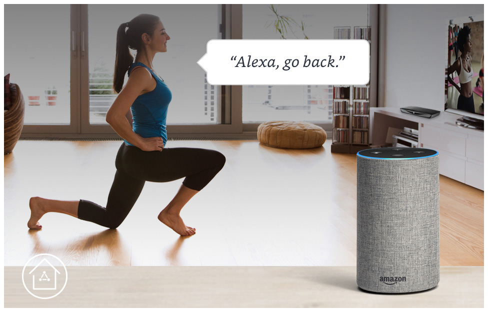 woman doingh yoga in her living room while commanding alexa